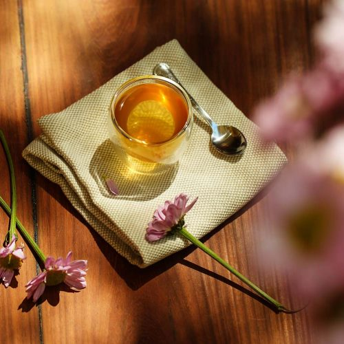 a glass of tea and honey